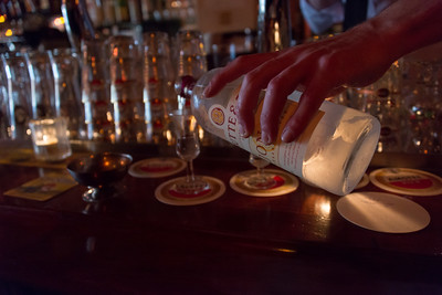 A famous brown bar, found in Amsterdam. Volker, the bartender, pours Amsterdam's well-known spirit, jenever.
