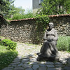 A statue of Botev's mother outside the Botev house and museum.
