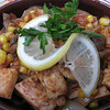 Chicken kavarma - baked in a clay pot, with corn, onions, and tomatoes.