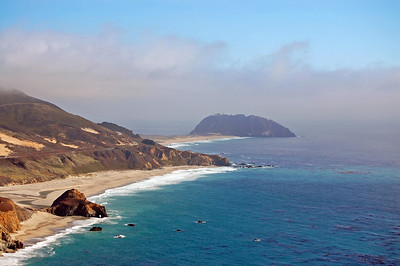 View from the Pacific Coast Highway with Point Sur in the distance.