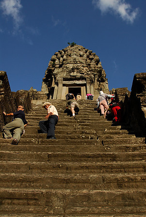 This is one of the steep stairs to the center part of Angkor Wat. But it was rarely used to come down. Most people were afraid and used the only stair on the other side that has a rope for support (see picture on the next page).