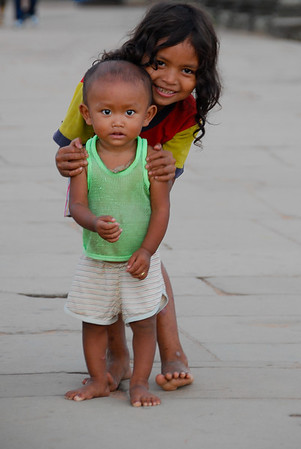 Little boy with his sister. We gave some extra money to this sweet children.