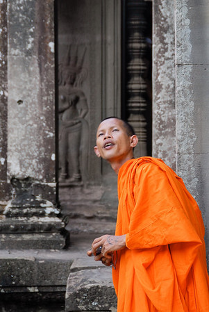 Tourist monk armed with camera.