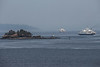 Islet and Two Ferries