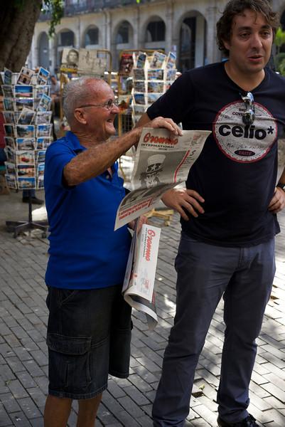 Architecto Daniel with newspaper vendor