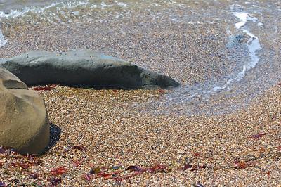 The pebbles along Pebble Beach.