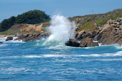 The view of waves crashing into rocks along Pebble Beach.