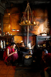 Tibetan monks in their little kitchen.