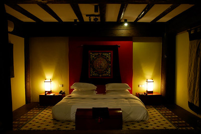 Our beautiful Tibetan house at the Banyan Tree Hotel. High quality and very expensive. The bed is 8 feet wide and 7.5 feet long. An imperial bed.....!