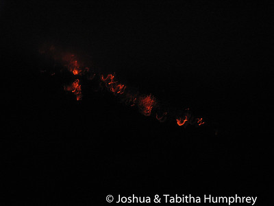 Night shots of lava flowing from Arenal volcano.