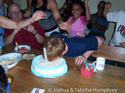 Costa Rican tradition. Biting the cake.