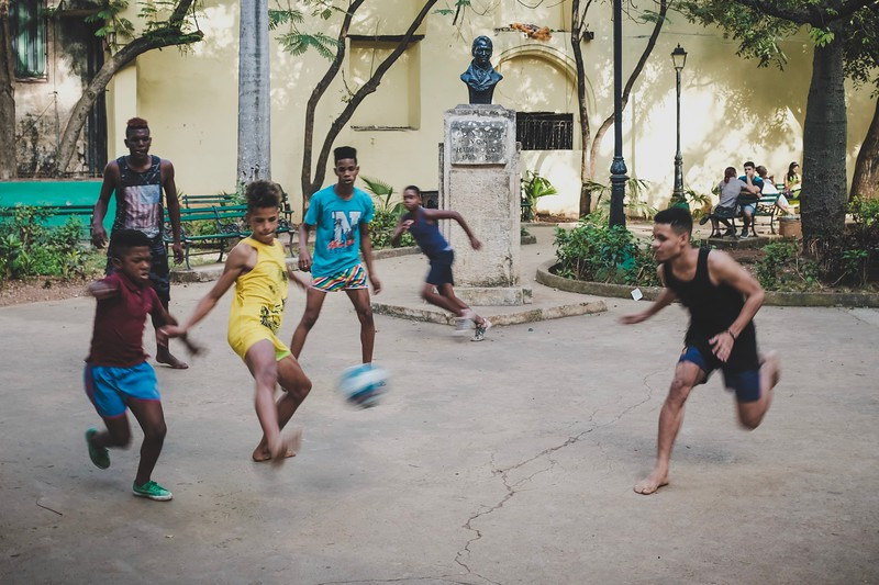 Cuban kids play soccer barefoot in the streets of Havana.