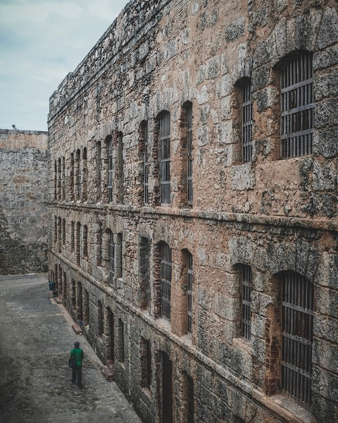 A visitor strolls through Castillo de los Tres Reyes Magos del Morro
