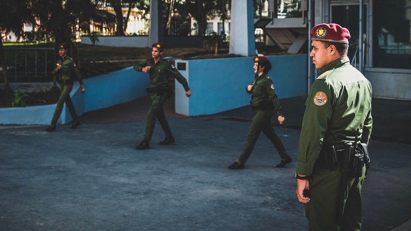 A military personnel supervises the guard rotation at the Museum of the Revolution in Havana.