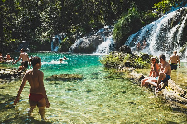 Cubans and tourists enjoy the waters of El Nicho waterfalls outside of Cienfuegos.