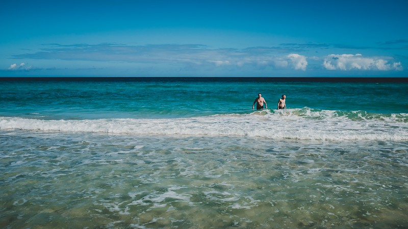 US tourists enjoy the clear water and gentle waves of Santa Maria beach outside Havana.