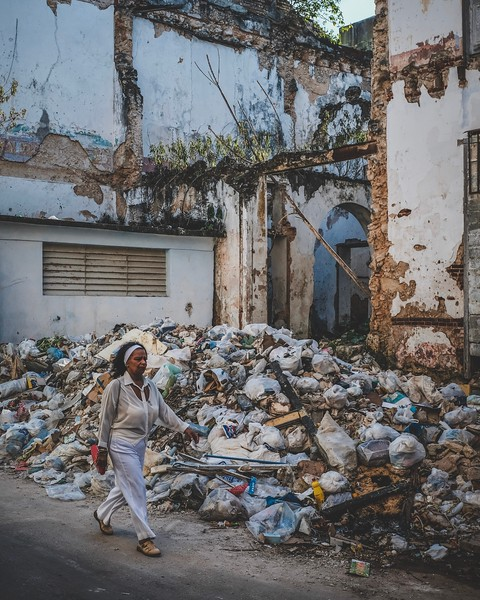 Piles of trash and crumbling buildings are common sights in the streets of Havana