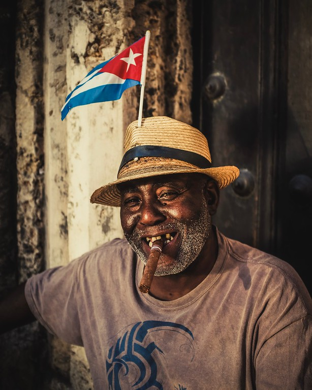 Elpidio was sitting on steps outside Havana's Cathedral, enjoying the last sun rays of the day.