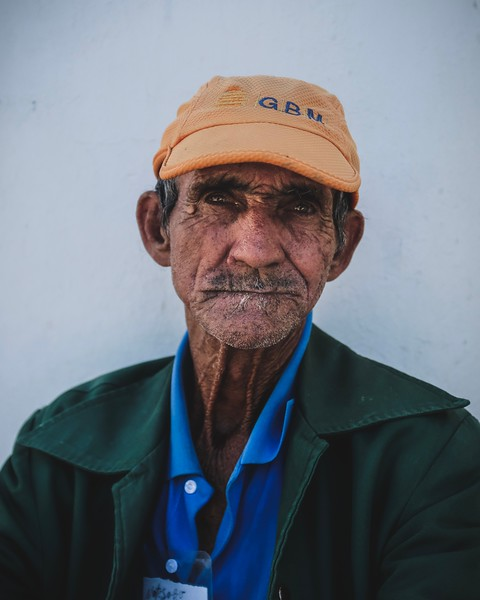Cuban sitting in the shade of the Cienfuegos Cathedral.