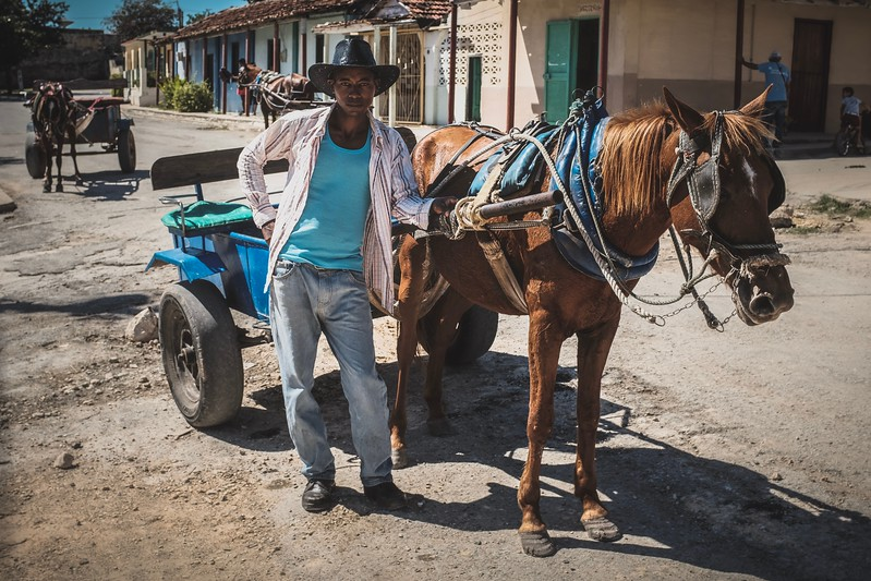 This young Cuban was the driver of this horse cart. I handed this man a 5 CUC tip (one sixth of Cuba's average monthly salary). As soon as I turned around, his boss grabbed the tip from him.