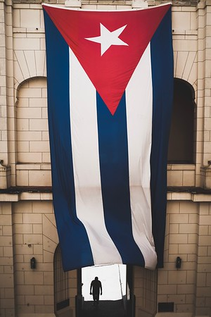 A massive Cuban flag hangs in the atrium of the Museum of the Revolution in Havana.