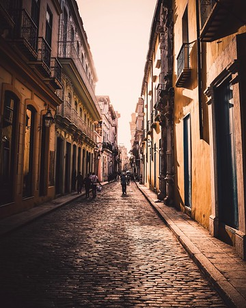 The sun sets in the streets of old town Havana, Cuba.