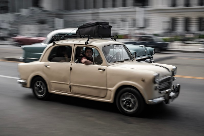 A Cuban family drives their car in Havana.