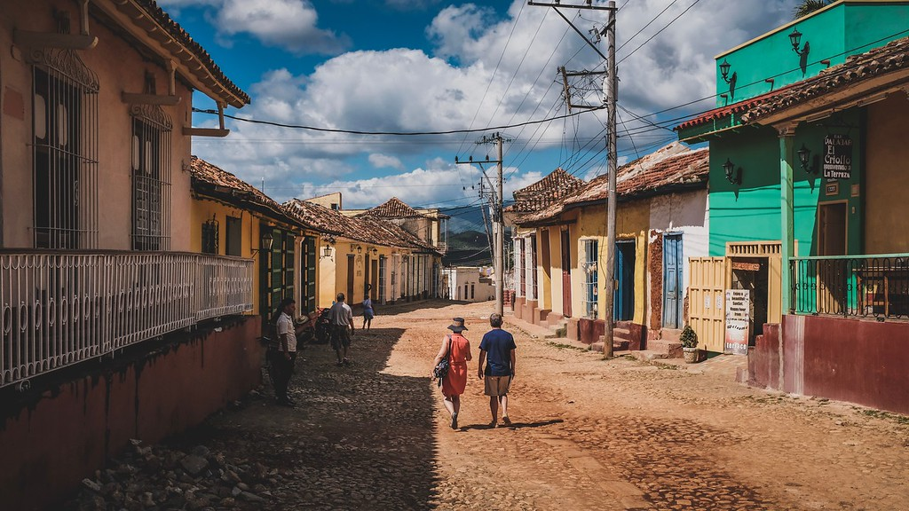Tourists walking the streets of Trinidad, Cuba