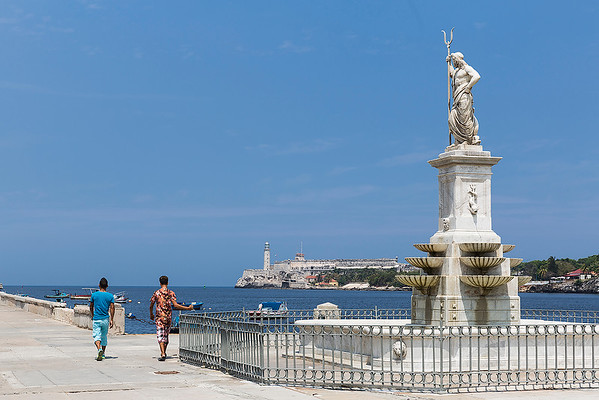 Neptune statue in Old Town area with the sea fortress at the mouth of the harbor