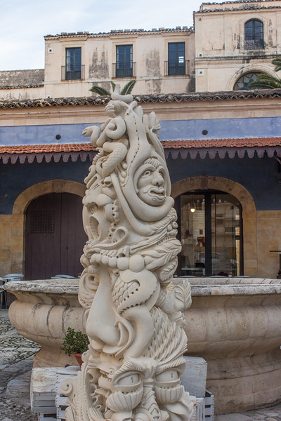 Noto - Courtyard with Funny Sculpture