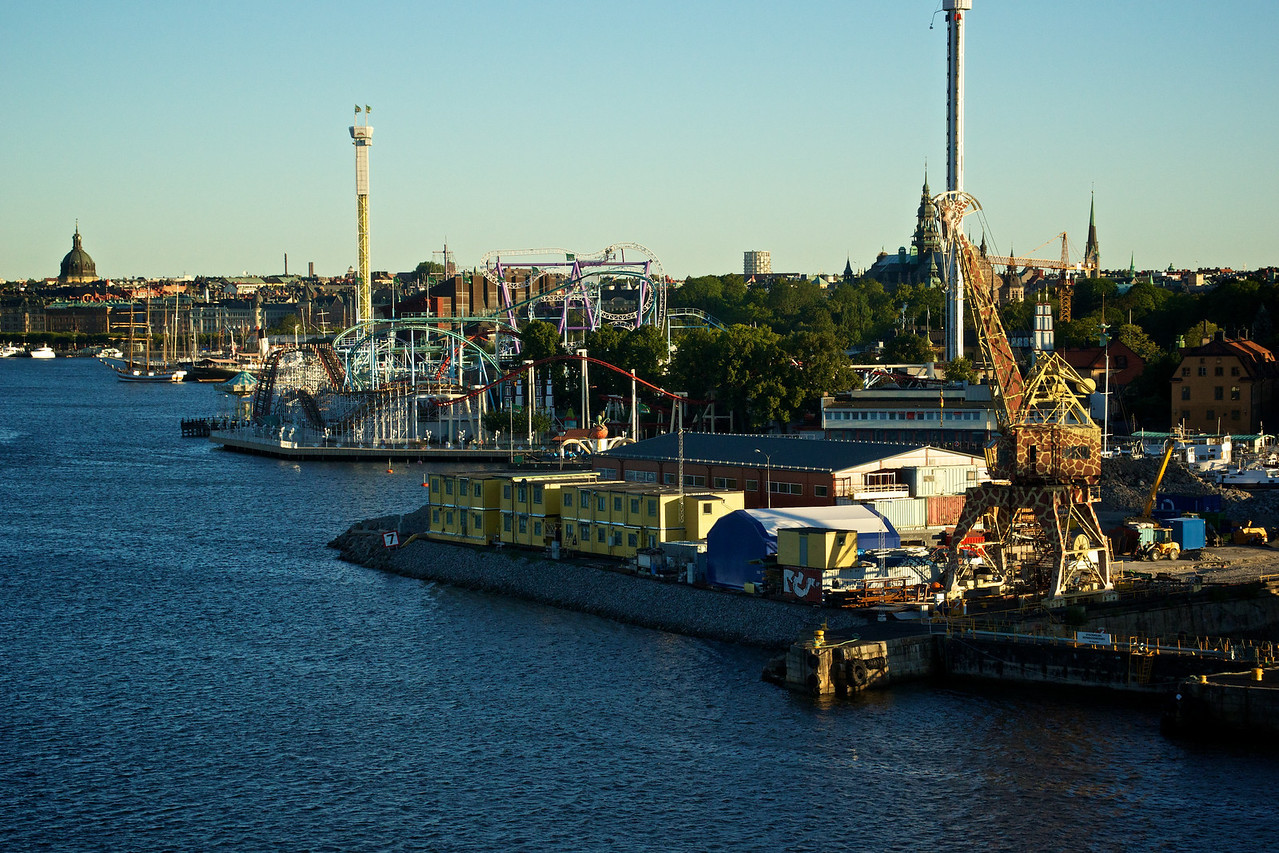 Crane (painted to resemble a giraffe) and amusement park Stockholm waterfront.
