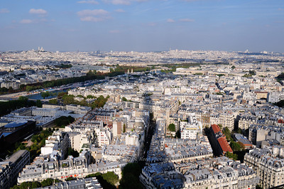 The shadow of the Eiffel Tower over the Paris cityscape