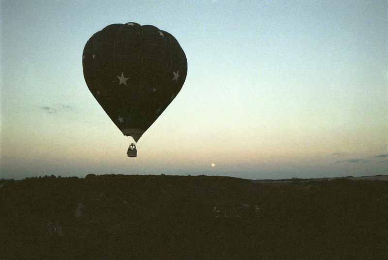 Balloon ride over Burgundy at twilight.