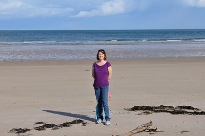 Lisa on the beach at Bamburgh Castle