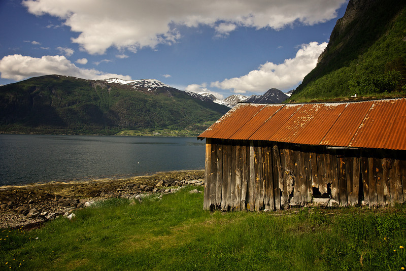 Boathouse, Glacial Lake and Snow capped mountains