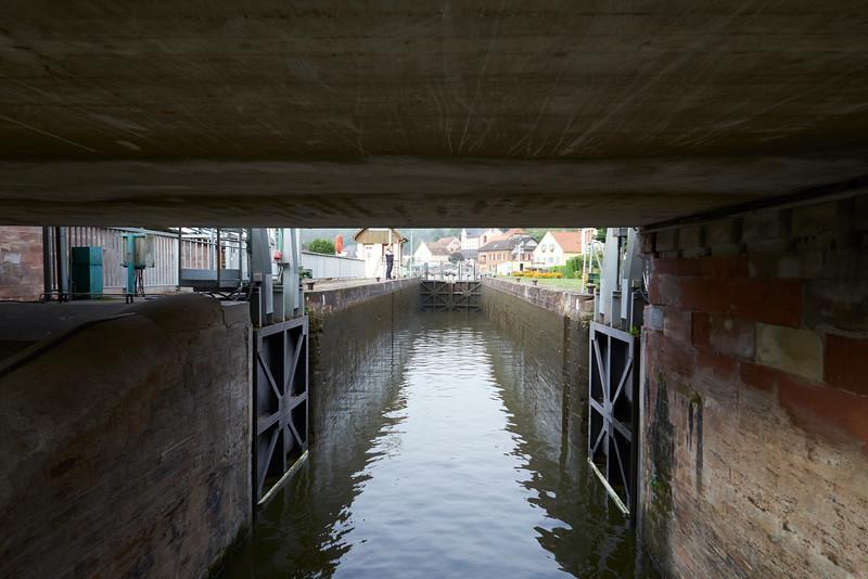 Under a low bridge into a lock