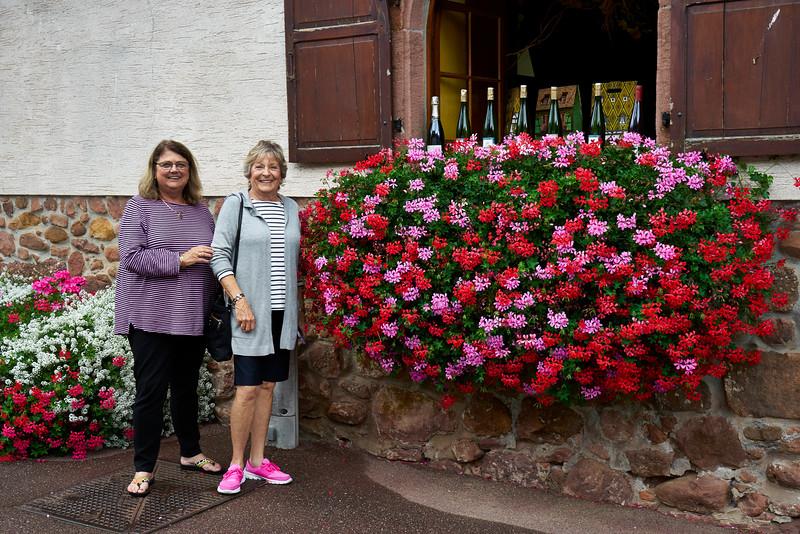 Linda, Sarah, flowers and wine