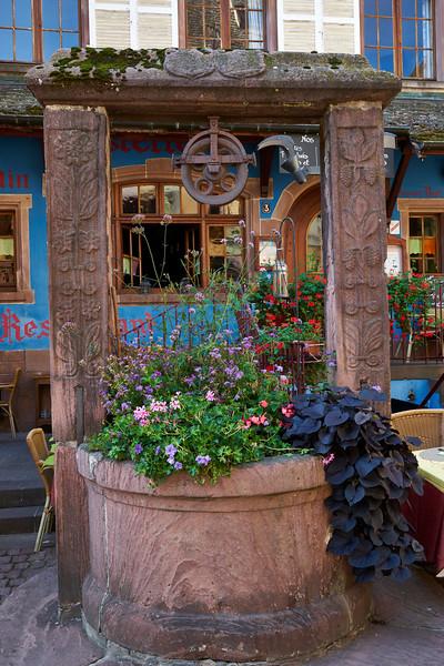 Well with flowers Riquewihr route de vin Alsace