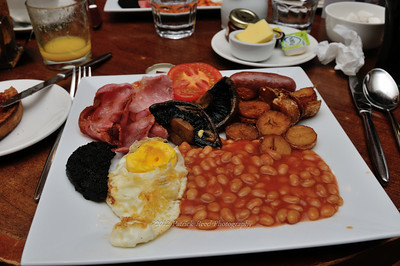 "The ""Full"" English Breakfast. Includes egg, canadian ham, portabello mushrooms, potatoes, sausage, blood pudding, baked beans, and tomato."