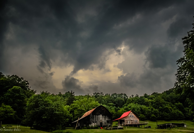 Barn and bakery in a stormy sky