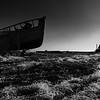 Derelict fishing net and boat.