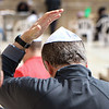 Placing a Kippot or Yamaka on head as a sign of respect for Jewish tradition as we approach the wall.