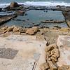Partially sunken ruins of a bathhouse.