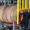 Red wine in fermentation barrels.