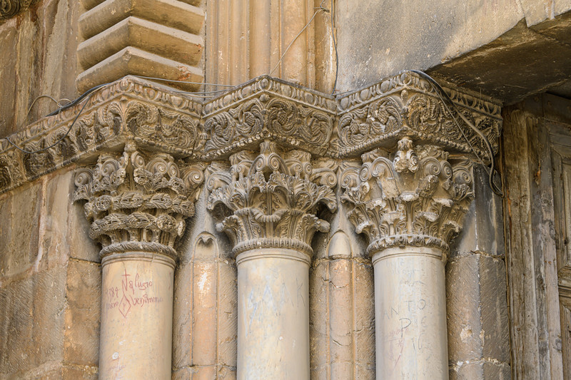 Classic Corinthian Columns and modern era cables on the outside of the church.