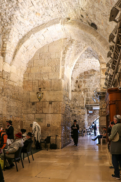 Inside a tunnel beside the Wailing Wall, men only area