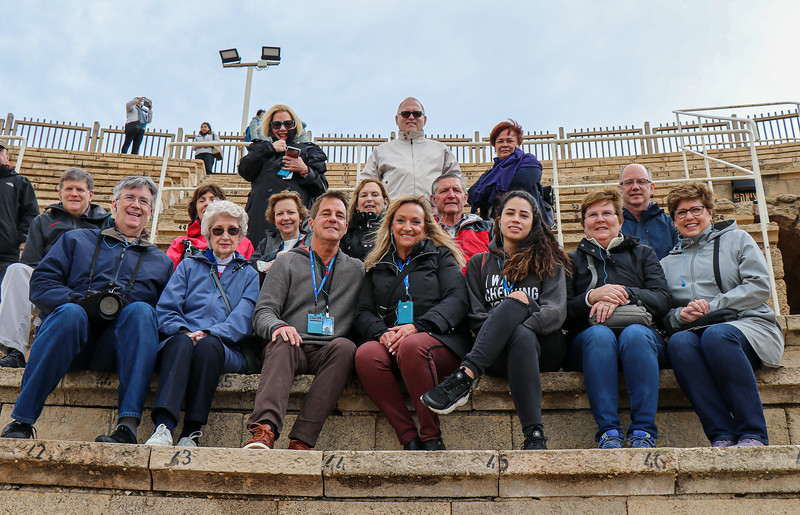 Our group, sitting in the partially rebuilt remains of an ancient theater.