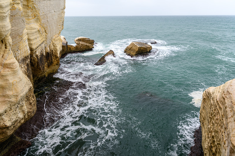 Mediterranean churning near the grotto entrance.
