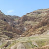 View west from the site of the ruins up a valley which sporadically carries water from the high lands and is marked by numerous caves.