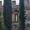 Arrow slit visible in Ottoman era wall.
